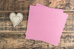 Wooden heart on  texture. Wooden heart on wooden texture and sticker under the text Stock Image