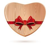 Wooden heart tied with red ribbon. Heart icon. Wooden Valentines heart. Romantic design concept. Vector illustration Stock Photos
