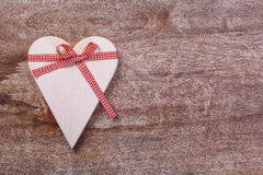 Wooden heart tied with ribbon Royalty Free Stock Photos