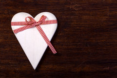 Wooden heart tied with ribbon Stock Image