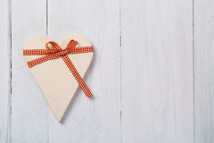 Wooden heart tied with ribbon Royalty Free Stock Image