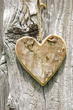 Wooden heart on tree bark Stock Photo