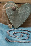 Wooden heart in turquoise Stock Photography