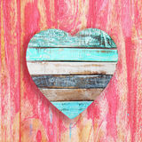 Wooden heart on vintage background Royalty Free Stock Photos