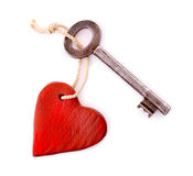 Wooden heart with vintage key isolated Royalty Free Stock Photos