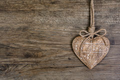 Wooden heart on vintage oak background, text space Stock Photo