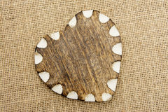 Wooden Heart with White Edge On Hessian Royalty Free Stock Images