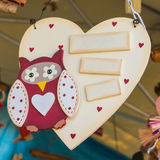 Wooden heart white painted on a rope with owl Stock Photos