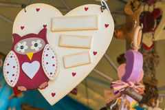 Wooden heart white painted on a rope with owl Stock Image