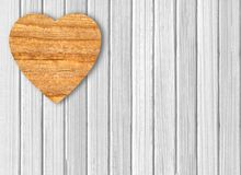 Wooden heart on white wooden Stock Photography
