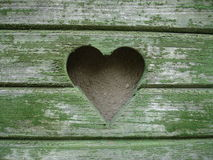 Wooden heart on a window shutters Royalty Free Stock Photography
