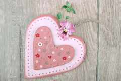 Wooden heart on wood with flowers Royalty Free Stock Photos