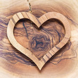 Wooden heart on wooden background Royalty Free Stock Photography
