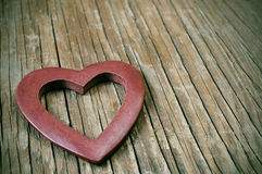 Wooden heart on a wooden surface with a filter effect Stock Images