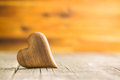 Wooden heart on wooden table. Royalty Free Stock Photography