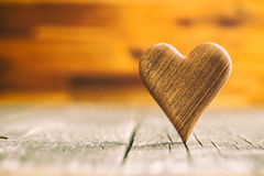 Wooden heart on wooden table. Stock Photo