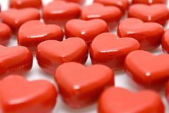 Wooden hearts. Rows of red wooden hearts - close-up view stock photography