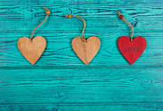 Wooden hearts on a blue background. Pendants made of wood in the form of heart. Top view Royalty Free Stock Image