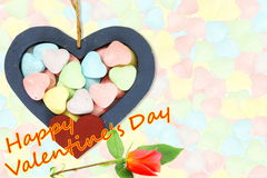Wooden Hearts with candy Valentine Background with red rose and happy valentine text in candy  background Stock Photos