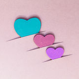 The wooden hearts on cardboard background. Concept for love and wedding royalty free stock photos
