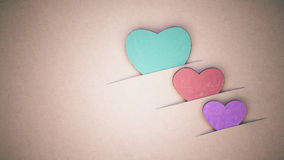 The wooden hearts on cardboard background. Royalty Free Stock Photo