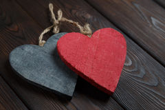 Wooden hearts on dark wood background Royalty Free Stock Images