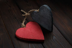 Wooden hearts on dark wood background Stock Photo