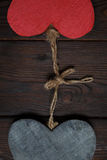 Wooden hearts on dark wood background Royalty Free Stock Photos