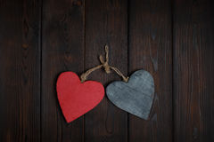 Wooden hearts on dark wood background Stock Image