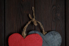 Wooden hearts on dark wood background Royalty Free Stock Photography