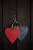 Wooden hearts on dark wood background Stock Photography
