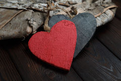 Wooden hearts on dark wood background Royalty Free Stock Photo