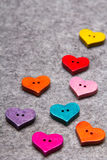 Wooden hearts on gray felt background Stock Photo