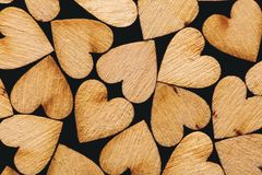 Wooden hearts laying together tightly Stock Images