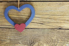 Wooden  hearts in old wooden background Royalty Free Stock Image