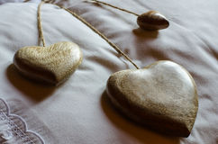 Wooden hearts on the pillow. Rustic romantic background Royalty Free Stock Photos
