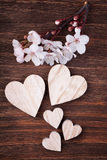 Wooden hearts placed nicely with spring cherry blossom flowers Stock Photo