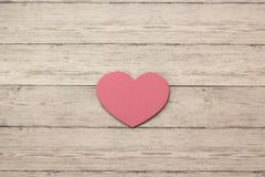 Wooden hearts placed nicely on a wood backgroud Stock Photography