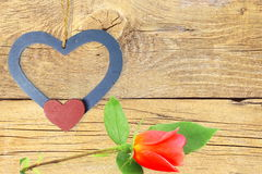 Wooden  hearts with red rose in old wooden background Royalty Free Stock Photos