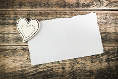 Wooden hearts and a sheet of paper. On wooden texture Stock Image