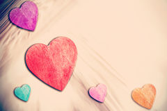 Wooden hearts on timbered background, space for text Stock Images
