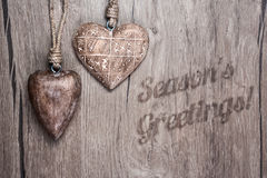 Wooden hearts on a vintage wooden background Seasonal Greetings Royalty Free Stock Photo