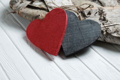 Wooden hearts on white wood background Stock Photography