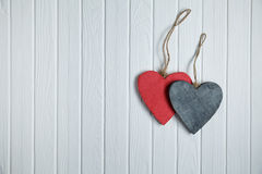 Wooden hearts on white wood background Royalty Free Stock Photo