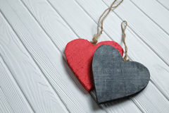 Wooden hearts on white wood background Royalty Free Stock Image