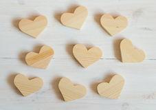Wooden hearts on white wooden background Royalty Free Stock Photo