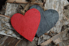Wooden hearts on wood background Stock Image