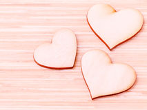 The wooden hearts on wooden background. Royalty Free Stock Photo