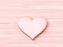 The wooden hearts on wooden background. Royalty Free Stock Image