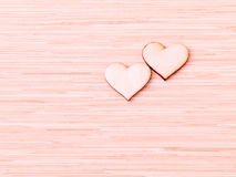 The wooden hearts on wooden background. Royalty Free Stock Images